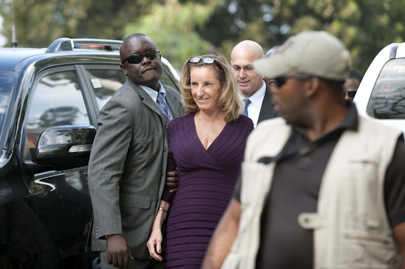 US Ambassador to Haiti Pamela White (C) arrives for a meeting with members of opposition political parties to the government of President Michel Martelly, in Port-au-Prince, on December 2, 2014