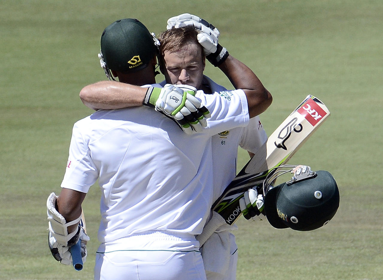 South African batsman AB de Villiers (R) is congratulated by his teammate batsman Vernon Philander for his century during the second day of the third Test match between South Africa and Pakistan on February 23, 2013 at Super Sport Park in Centurion. AFP PHOTO / STEPHANE DE SAKUTIN        (Photo credit should read STEPHANE DE SAKUTIN/AFP/Getty Images)