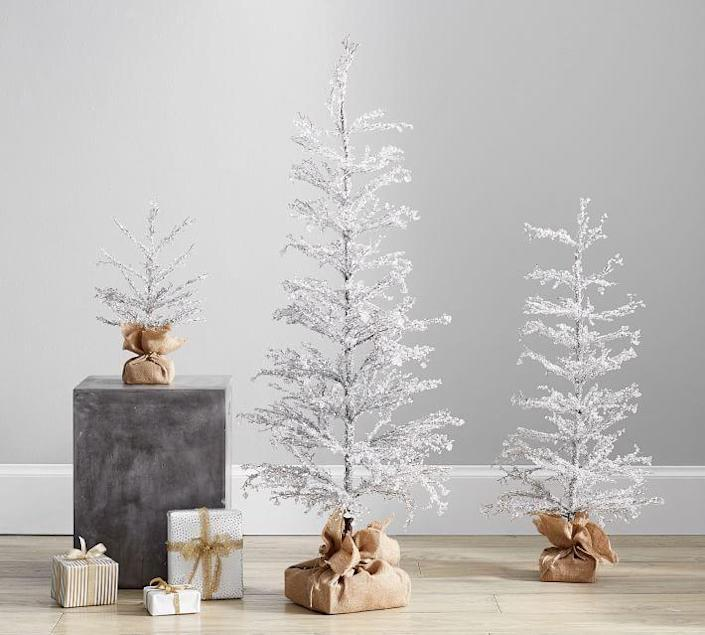 """<p>potterybarn.com</p><p><strong>$199.00</strong></p><p><a href=""""https://go.redirectingat.com?id=74968X1596630&url=https%3A%2F%2Fwww.potterybarn.com%2Fproducts%2Fpre-lit-snowy-crystal-trees&sref=https%3A%2F%2Fwww.thepioneerwoman.com%2Fholidays-celebrations%2Fg37635843%2Fwhite-christmas-tree-decorations%2F"""" rel=""""nofollow noopener"""" target=""""_blank"""" data-ylk=""""slk:Shop Now"""" class=""""link rapid-noclick-resp"""">Shop Now</a></p><p>These stunning, pre-lit crystal trees would make a magical addition to your holiday decorations. They come in three sizes: 18 inches, 36 inches and 48 inches. Don't they look pretty displayed together?</p>"""