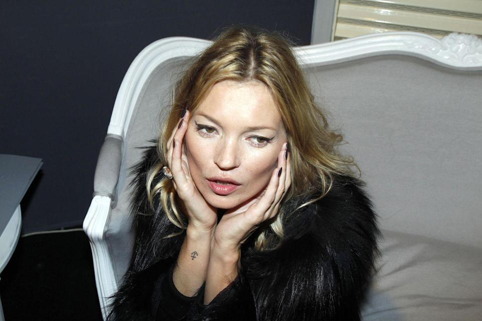 <p>A small anchor adorns Kate Moss's lower forearm.</p>