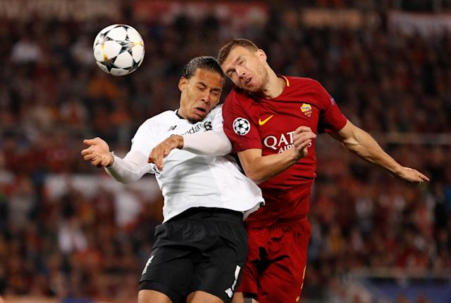 Soccer Football - Champions League Semi Final Second Leg - AS Roma v Liverpool - Stadio Olimpico, Rome, Italy - May 2, 2018 Roma's Edin Dzeko in action with Liverpool's Virgil van Dijk Action Images via Reuters/John Sibley TPX IMAGES OF THE DAY