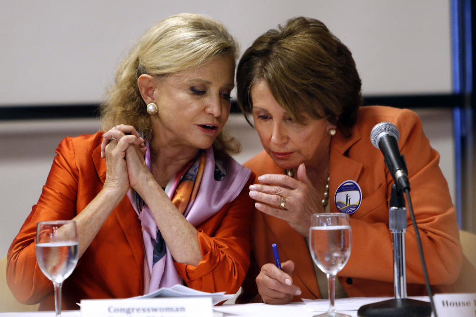 FILE - In this Oct. 4, 2013 file photo, Rep. Carolyn Maloney, D-N.Y., left, talks withHouse Minority Leader Nancy Pelosi of Calif. at Hunter College in New York. Republicans are the party of the rich, right? It's a label that has stuck for decades, and you're hearing it again as Democrats complain about Republican opposition to raising the minimum wage and extending unemployment benefits. Of the 10 richest districts, New York 12th Congressional, Maloney's, which includes Manhattan's Upper East Side, as well as parts of Queens and Brooklyn. Maloney is in her 11th term representing the district. (AP Photo/Jason DeCrow, File)