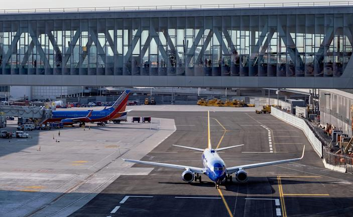 A Southwest aircraft moves along a new taxiway at LaGuardia Airport, Thursday, May 20, 2021, in New York.