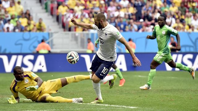 Nigeria's goalkeeper Vincent Enyeama makes a save from France's Karim Benzema during the World Cup round of 16 soccer match between France and Nigeria at the Estadio Nacional in Brasilia, Brazil, Monday, June 30, 2014