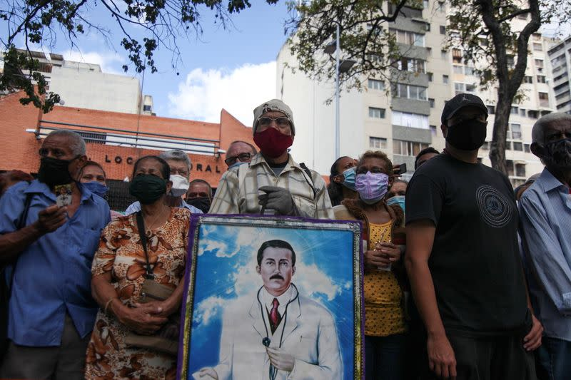 People gather outside of the Our Lady of La Candelaria church in Caracas