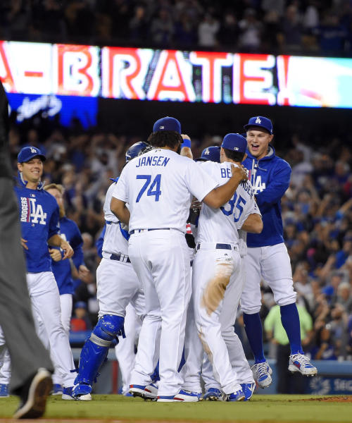 Los Angeles Dodgers celebrate after they defeated the San Francisco Giants 4-2 in a baseball game and won the NL West title Friday, Sept. 22, 2017, in Los Angeles. (AP Photo/Mark J. Terrill)
