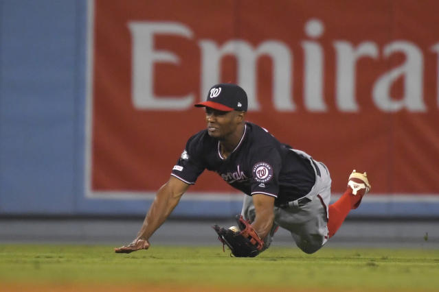 Washington Nationals center fielder Michael A. Taylor catches a fly ball hit by Los Angeles Dodgers' Justin Turner for the final out in the 10th inning of Game 5 of a baseball National League Division Series on Wednesday, Oct. 9, 2019, in Los Angeles. The Nationals won 7-3. (AP Photo/Mark J. Terrill)