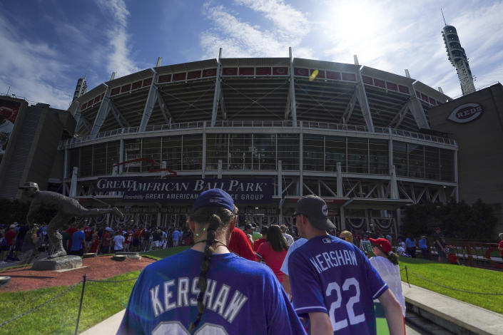 Los Angeles Dodgers' fans wait outside of Great American Ball Park prior to a baseball game between the Cincinnati Reds and the Los Angeles Dodgers in Cincinnati, Sunday, Sept 19, 2021. (AP Photo/Bryan Woolston)