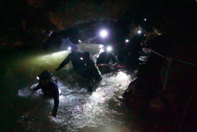 Rescue teams inside the cave complex where 12 boys and their football coach went missing. (Photo: PA)