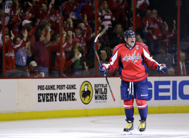 Washington Capitals right wing Alex Ovechkin (8), from Russia, celebrates his first goal in the second period of an NHL hockey game against the Calgary Flames, Thursday, Oct. 3, 2013, in Washington. (AP Photo/Alex Brandon)
