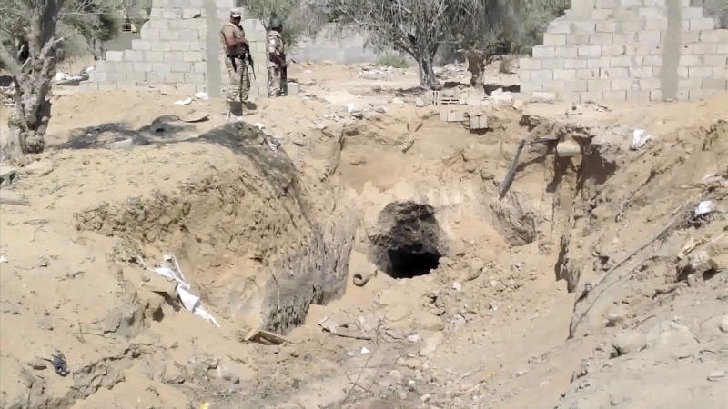 In this image taken from video, Egyptian Army personnel supervise the destruction of tunnels between Egypt and the Gaza Strip at the border, near the town of Rafah, northern Sinai, Egypt, Tuesday Sept. 3, 2013. Tunnels between Egypt and the Gaza have been used to smuggle everything from weapons, to cigarettes and fuel but now the Egyptian military appears determined to close the tunnels once and for all. (AP Photo/AP Television)