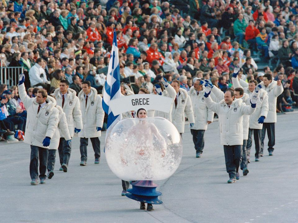 woman wearing a snow globe costume at olympics