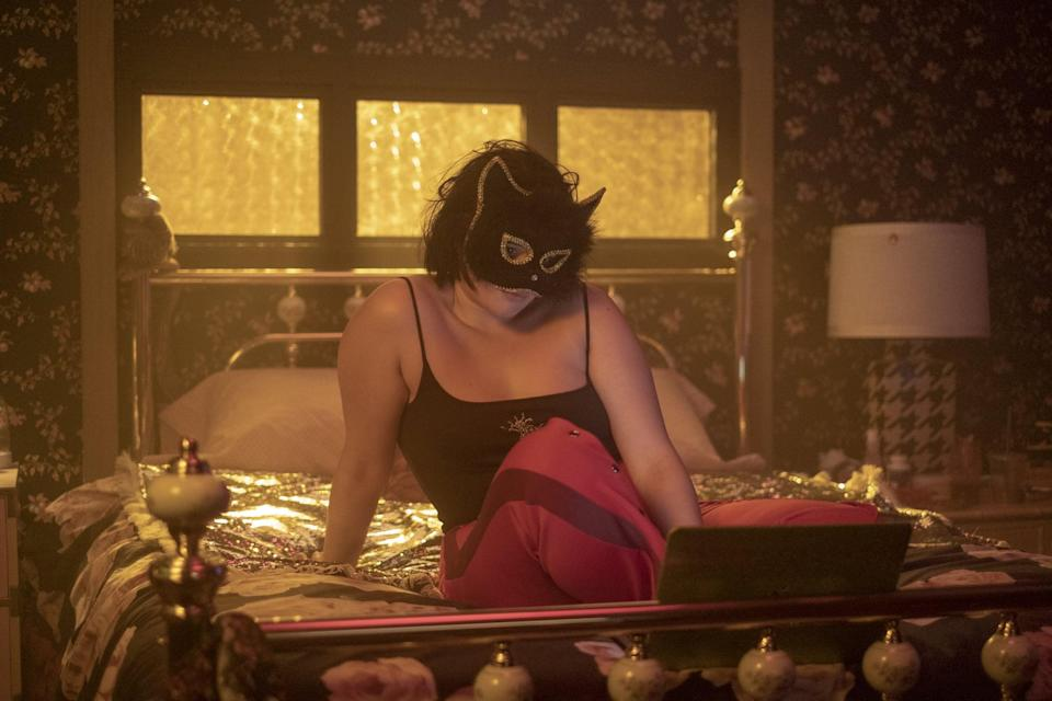 """<p>We like to call this look the """"Kitty Kat,"""" for obvious reasons. Channel your webcam girl charm, and let this costume take you to totally uncharted waters. If you want to hide, but also stand out, this look of Kat's gives you the best of both worlds. Not to mention, the easy-to-throw-on pajamas and the quick cat mask make this outfit perfect for those last-minute costume parties.</p> <p><strong>What to wear</strong>: Red velvet joggers, a small back cami, and a gold-lined cat mask are the only pieces you need to complete Kat's sexy nighttime outfit. Get ready to bring out the bad.</p>"""