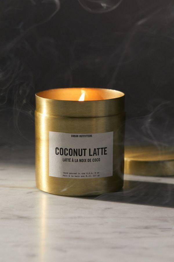 """<p>The only issue we take with this gilded tin of creamy coconut layered fragrance is that we can't actually sip it.</p><br><br><strong>Urban Outfitters</strong> Harper Tin Candle, $20, available at <a href=""""https://www.urbanoutfitters.com/shop/harper-tin-candle?category=SEARCHRESULTS&color=070&quantity=1&size=ONE%20SIZE&type=REGULAR"""" rel=""""nofollow noopener"""" target=""""_blank"""" data-ylk=""""slk:Urban Outfitters"""" class=""""link rapid-noclick-resp"""">Urban Outfitters</a>"""