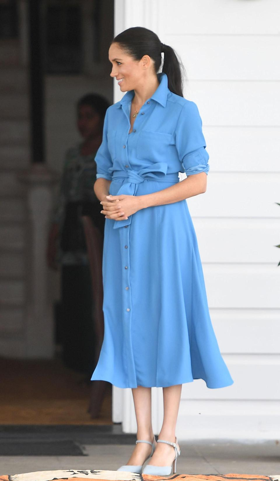 <p>On October 26, the Duchess of Sussex wore a $595 (approx £465) Veronica Beard shirt dress for a trip to Tupou College and Toloa rainforest. She teamed the maternity look with Aquazurra heels – which promptly sold out online. <em>[Photo: Getty]</em> </p>