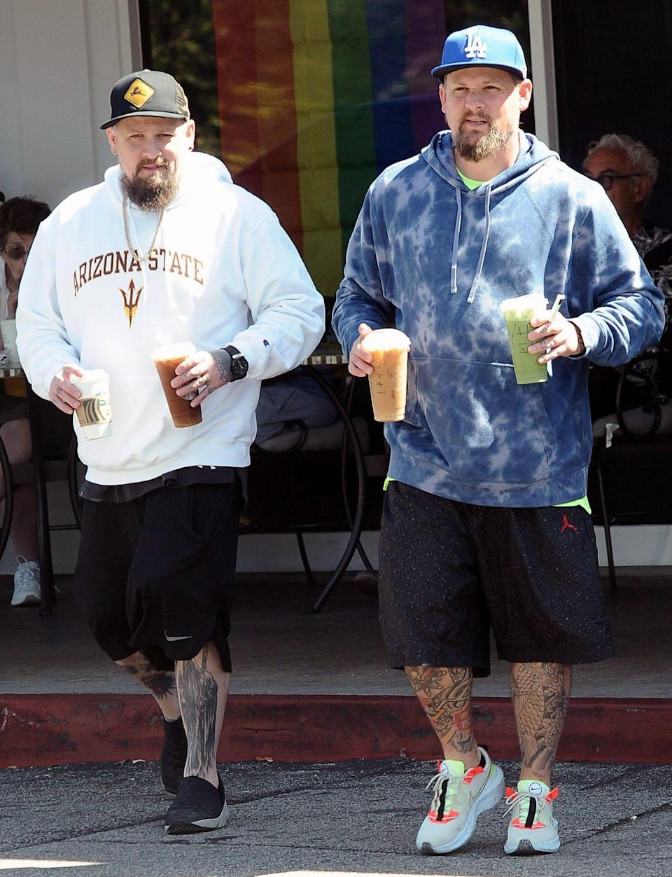 <p>Joel and Benji Madden grab drinks to go while out in Beverly Hills on June 28.</p>