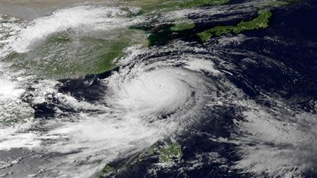 NOAA handout satellite image shows Super Typhoon Usagi heading west-northwest between the Philippines and Taiwan through the Luzon Strait