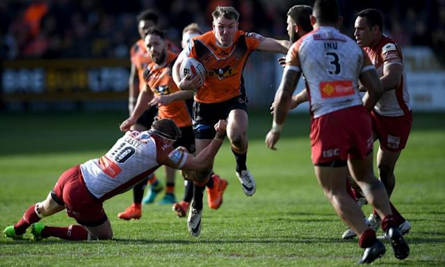"""<span class=""""element-image__caption"""">Castleford's Michael Shenton is tackled by Rémi Casty of Catalans during the Super League match.</span> <span class=""""element-image__credit"""">Photograph: Gareth Copley/Getty Images</span>"""