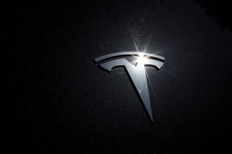 FILE PHOTO: FILE PHOTO: The Tesla logo is seen on a car in Los Angeles