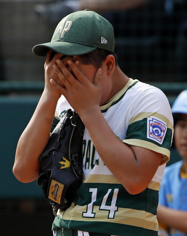 South Korea pitcher Yeong Hyeon Kim collects himself after allowing a run to score from third on a wild pitch in the third inning of the Little League World Series Championship baseball game against Honolulu, Hawaii, in South Williamsport, Pa., Sunday, Aug. 26, 2018. (AP Photo/Gene J. Puskar).