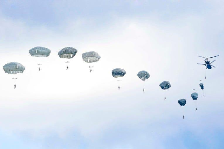 Army paratroopers jump from a CH-47 Chinook helicopter over the Bunker drop zone at Grafenwoehr Training Area, Germany, Aug. 14, 2019.