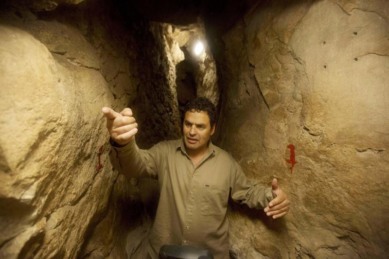 In this Thursday, May 1, 2014, photo, Eli Shukron, an archeologist formerly with Israel's Antiquities Authority, walks in the City of David archaeological site near Jerusalem's Old City. The dig, which began in 1995, uncovered a massive fortification and pottery shards that date to 3,800 years old. Shukron says this is the legendary citadel captured by King David in his conquest of Jerusalem. But archaeologists are divided on identifying Davidic sites in Jerusalem, the city he is said to have made his capital. (AP Photo/Sebastian Scheiner)