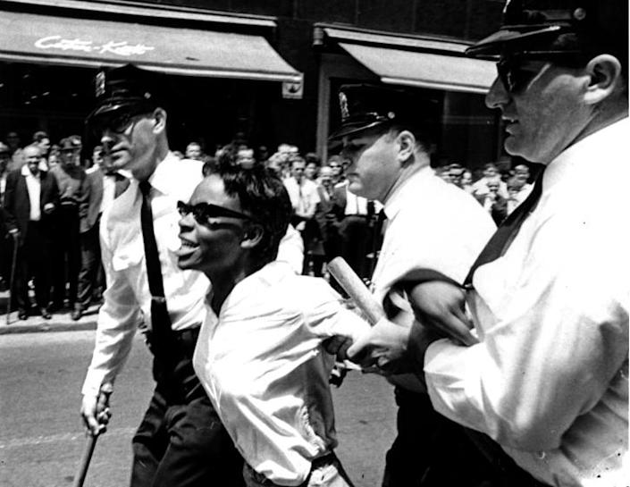 Bertha Gilbert, 22, is led away by police after she tried to enter a segregated lunch counter in Nashville, Tenn., on May 6, 1964. She is arrested on a disorderly conduct charge. (AP Photo)