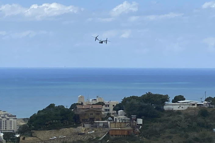 FILE - IN this Thursday, March 19, 2020 file photo, a U.S. Marine Osprey is seen taking off from the U.S. Embassy in Aukar, northeast of Beirut, Lebanon. The aircraft took off a few hours before a U.S. senator announced that Lebanese-American Amer Fakhoury, who had faced decades-old murder and torture charges in Lebanon, was freed from a prison in Lebanon. Lebanon's official National News Agency on Friday said Foreign Minister Nasif Hitti sought an explanation from Ambassador Dorothy Shea for the circumstances of Fakhoury's leaving the country. (AP Photo/Zeina Karam)