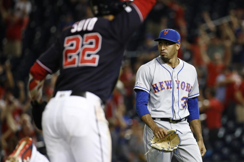New York Mets relief pitcher Edwin Diaz, right, walks off the field as Washington Nationals' Juan Soto scores on Kurt Suzuki's game-winning three-run home run during the ninth inning of a baseball game Tuesday, Sept. 3, 2019, in Washington. Washington won 11-10. (AP Photo/Patrick Semansky)