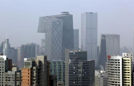 China Central Television Headquarters and other office buildings are pictured in Beijing's central business district