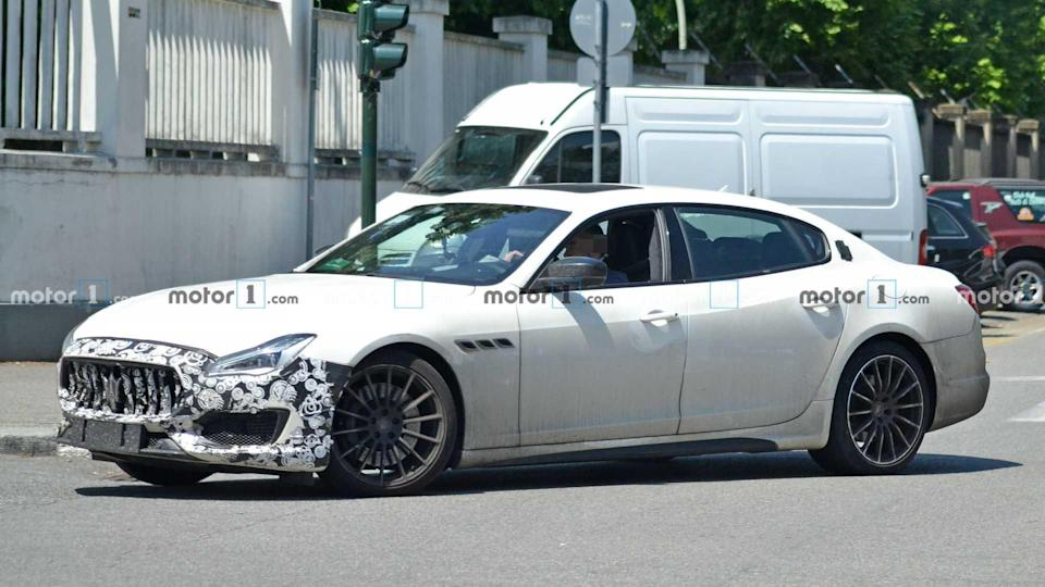 """<p>The Maserati <a href=""""https://www.motor1.com/maserati/quattroporte/"""" rel=""""nofollow noopener"""" target=""""_blank"""" data-ylk=""""slk:Quattroporte"""" class=""""link rapid-noclick-resp"""">Quattroporte</a> puts on its revised front end with changes to the headlights, grille, and lower fascia.</p> <h3><a href=""""https://www.motor1.com/news/436666/maserati-quattroporte-refresh-spy-shots/"""" rel=""""nofollow noopener"""" target=""""_blank"""" data-ylk=""""slk:Maserati Quattroporte Spied Barely Hiding Its New Nose"""" class=""""link rapid-noclick-resp"""">Maserati Quattroporte Spied Barely Hiding Its New Nose</a></h3> <h2>The Quattroporte Is Getting Some Updates:</h2><br><a href=""""https://www.motor1.com/news/436156/ghibli-quattroport-trofeo-teased/"""" rel=""""nofollow noopener"""" target=""""_blank"""" data-ylk=""""slk:Maserati Ghibli And Quattroporte Trofeo Teased Ahead Of August Debut"""" class=""""link rapid-noclick-resp"""">Maserati Ghibli And Quattroporte Trofeo Teased Ahead Of August Debut</a><br><a href=""""https://www.motor1.com/news/362744/new-maserati-2020-models-updated/"""" rel=""""nofollow noopener"""" target=""""_blank"""" data-ylk=""""slk:New Maserati, Facelifted Levante, Ghibli, Quattroporte Due In 2020"""" class=""""link rapid-noclick-resp"""">New Maserati, Facelifted Levante, Ghibli, Quattroporte Due In 2020</a><br>"""