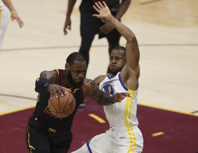 Golden State Warriors forward Andre Iguodala defends LeBron James in Game 3 of the NBA Finals. (AP Photo)