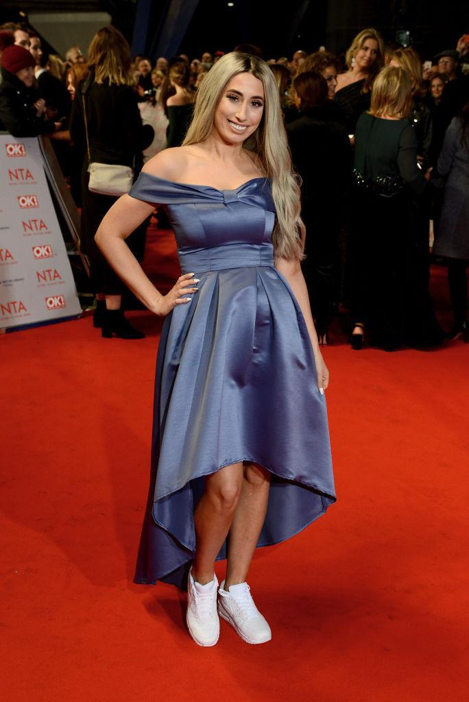 <p>Stacey Solomon broke all the fashion rules at this year's National Television Awards, as she teamed trainers with a cold-shoulder lilac dress on the red carpet. <em>[Photo: Getty]</em> </p>