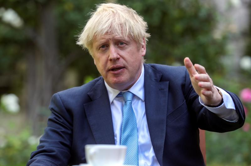 "Prime Minister Boris Johnson gestures as he meets Dame Barbara Windsor and her husband Scott Mitchell after they delivered an Alzheimer's Society open letter to 10 Downing Street in Westminster, London, calling on him to address the ""devastating state"" of dementia care."