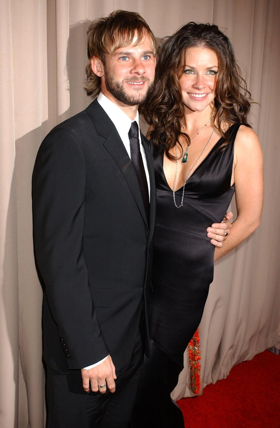 """<p>Evangeline and Dominic connected on the set of<strong> Lost</strong>, and though their characters, Kate and Charlie, never got together, the actors dated from 2004 to 2007. After deciding to call it quits, both actors remained on the series until its finale in 2010, although Dominic didn't appear in season five and only appeared in flashbacks in season six. </p> <p>The pair never explicitly commented on their breakup or their experience working together on <strong>Lost </strong>afterward, but Dominic <em>did </em>seem to shade Evangeline years later. In 2013, <a href=""""http://twitter.com/domswildthings/status/413398258979860481"""" class=""""link rapid-noclick-resp"""" rel=""""nofollow noopener"""" target=""""_blank"""" data-ylk=""""slk:Dominic replied to a tweet"""">Dominic replied to a tweet</a> that read, """"Evangeline looked unreal in The Hobbit, man oh man,"""" writing, """"Nah. I don't date cheaters."""" </p>"""