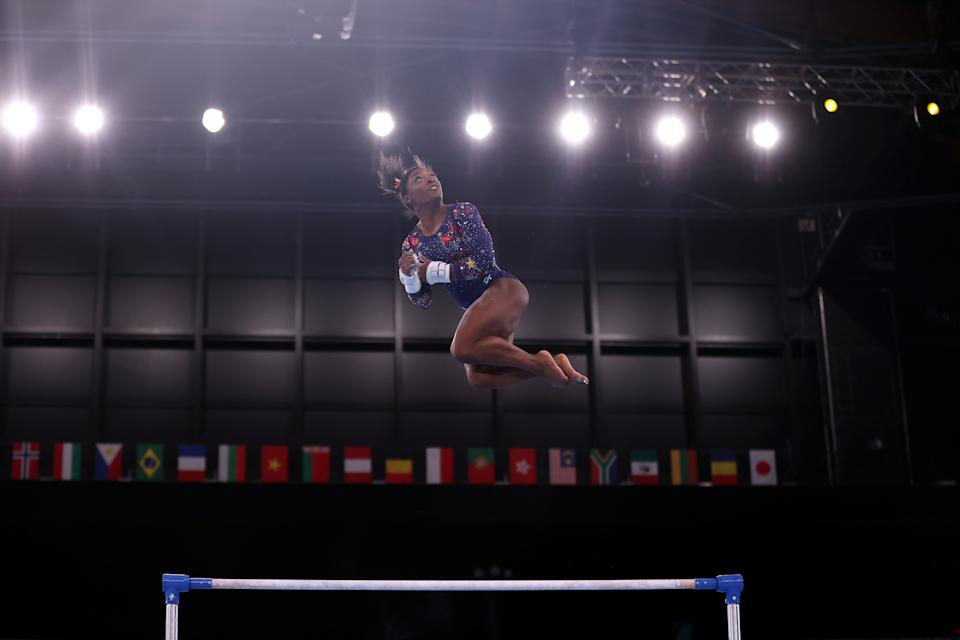<p>TOKYO, JAPAN - JULY 25: Simone Biles of Team United States competes on uneven bars during Women's Qualification on day two of the Tokyo 2020 Olympic Games at Ariake Gymnastics Centre on July 25, 2021 in Tokyo, Japan. (Photo by Laurence Griffiths/Getty Images)</p>