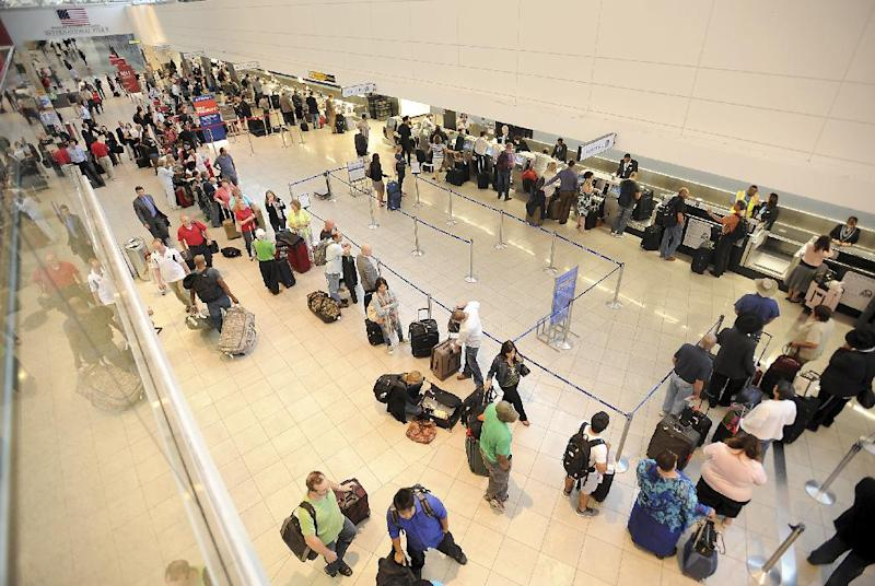 In this Thursday, Sept. 12, 2013 photo, long lines of passengers wait in Concourse D of Baltimore-Washington International Thurgood Marshall Airport, in Linthicum, Md., after many flights were either delayed or canceled because of a lightning strike to the airport's air traffic control tower, leading controllers to stop all arrivals and departures at the airport for more than two hours. The lightning strike, which also injured an air traffic controller, is prompting the Federal Aviation Administration to examine hundreds of air traffic control towers nationwide, the agency told The Associated Press. Officials will be looking for problems with the systems that protect the towers from lightning strikes. (AP Photo/The Capital, Paul W. Gillespie)