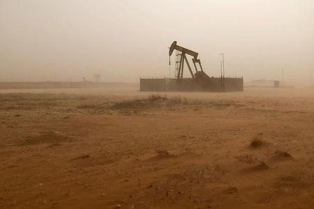 Pump jack lifts oil out of well during sandstorm in Midland