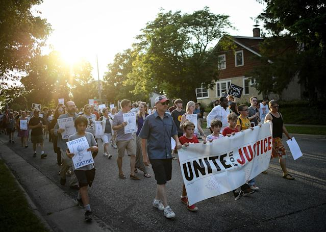 "<p>People march from the site of Justine Damond's shooting to Beard's Plaissance Park during the ""Peace and Justice March for Justine,"" Thursday, July 20, 2017, in Minneapolis, Minn. (Photo: Aaron Lavinsky/Star Tribune via AP) </p>"