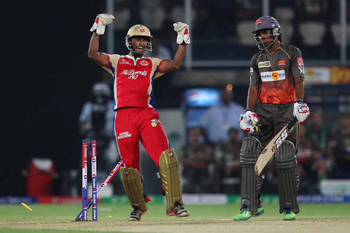 Akshath Reddy is bowled by Muttiah Muralitharan and Dinesh Karthik celebrates during match 7 of the Pepsi Indian Premier League between The Sunrisers Hyderabad and Royal Challengers Bangalore held at the Rajiv Gandhi International Stadium, Hyderabad on the 7th April 2013..Photo by Ron Gaunt-IPL-SPORTZPICS  ..Use of this image is subject to the terms and conditions as outlined by the BCCI. These terms can be found by following this link:..https://ec.yimg.com/ec?url=http%3a%2f%2fwww.sportzpics.co.za%2fimage%2fI0000SoRagM2cIEc&t=1506176738&sig=QcwFaAQ8CyCvMUcWwU94JQ--~D