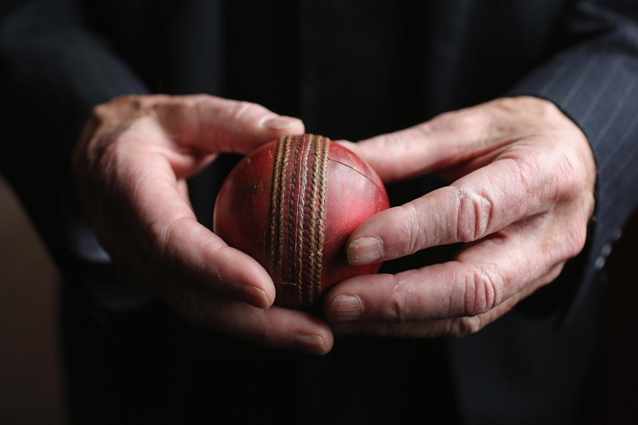 LONDON, ENGLAND - APRIL 05:  A man holds a cricket ball which was bowled during the over that Garfield Sobers hit six sixes in 1968 on April 5, 2012 in London, England. The item is feature in Bonhams' forthcoming Summer Sporting Sales and is expected to fetch 25,000 GBP  when auctioned alongside other sporting memorabilia on May 29, 2012.  (Photo by Oli Scarff/Getty Images)