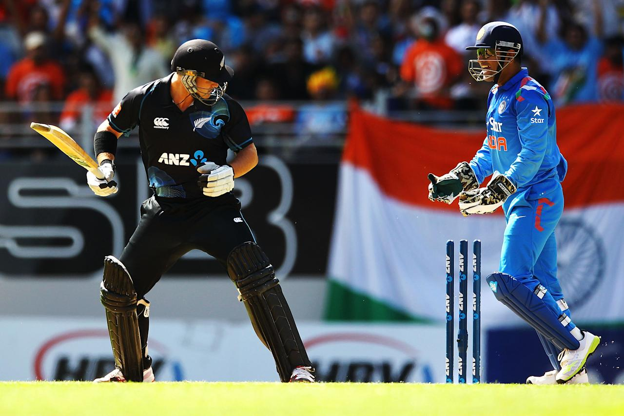 AUCKLAND, NEW ZEALAND - JANUARY 25: Corey Anderson of New Zealand looks at the stumps after being bowled by Ravichandran Ashwin of India as MS Dhoni starts to celebrate during the One Day International match between New Zealand and India at Eden Park on January 25, 2014 in Auckland, New Zealand.  (Photo by Anthony Au-Yeung/Getty Images)