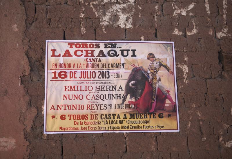 In this July 16, 2013 photo, a poster advertises an upcoming bullfighting event in Lachaqui, Peru. Crisis-displaced Iberian matadors including Nuno Casquinha and Emilo Serna are seeking fame in the rugged Andean backwaters of Peru. (AP Photo/Martin Mejia)
