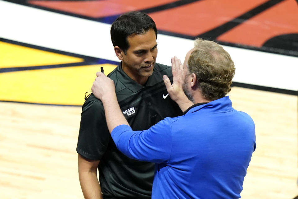Miami Heat head coach Erik Spoelstra, left, talks with Milwaukee Bucks head coach Mike Budenholzer after Game 4 of an NBA basketball first-round playoff series, Saturday, May 29, 2021, in Miami. The Bucks won 120-103. (AP Photo/Lynne Sladky)