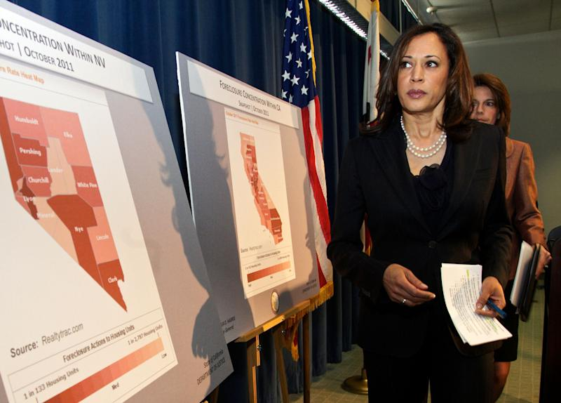 Attorneys General Kamala D. Harris of California, left, and Catherine Cortez Masto of Nevada walk past foreclosure charts of their states after they announce a joint investigation alliance to assist homeowners who have been harmed by misconduct and fraud in the mortgage industry, during a news conference in Los Angeles Tuesday, Dec. 6, 2011. (AP Photo/Damian Dovarganes)