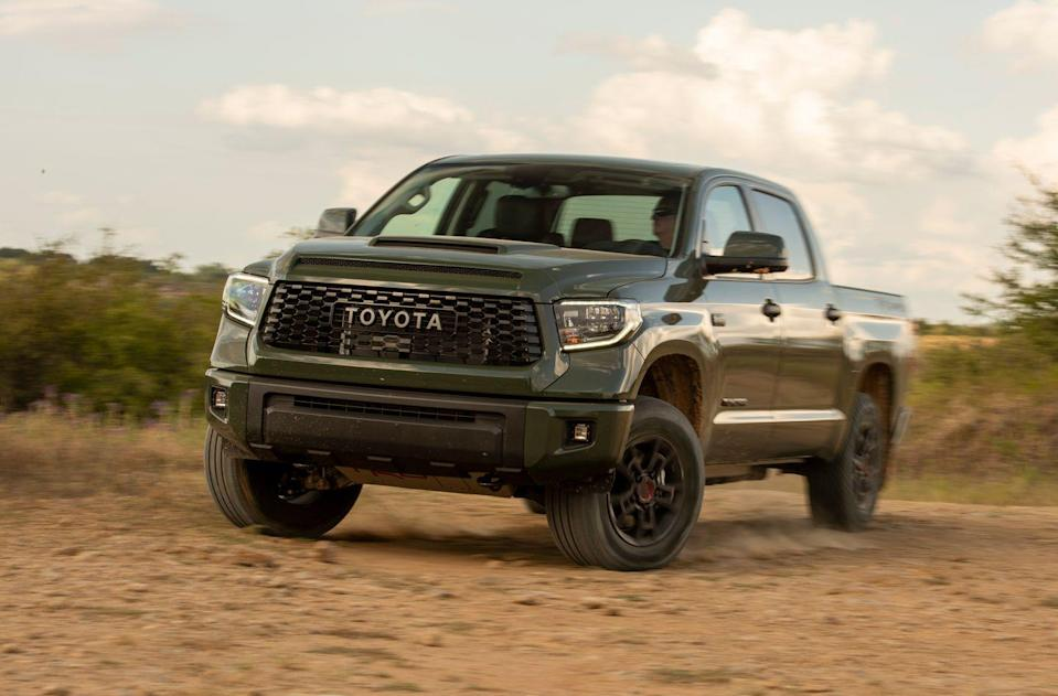 "<p><a href=""https://www.caranddriver.com/toyota/tundra"" rel=""nofollow noopener"" target=""_blank"" data-ylk=""slk:Toyota's Tundra"" class=""link rapid-noclick-resp"">Toyota's Tundra</a> is the company's biggest truck, and its TRD Pro version has the biggest talent. The TRD Pro's trail-ready equipment includes a 2.0-inch suspension lift, beefy Fox internal-bypass dampers, and specific front and rear springs. That results in 10.6 inches of ground clearance. It rides on a special set of 18-inch BBS wheels wrapped in Michelin all-terrain tires. Yeah, the TRD Pro has four-wheel drive and thick skid plates to protect vital vehicular vittles.</p>"