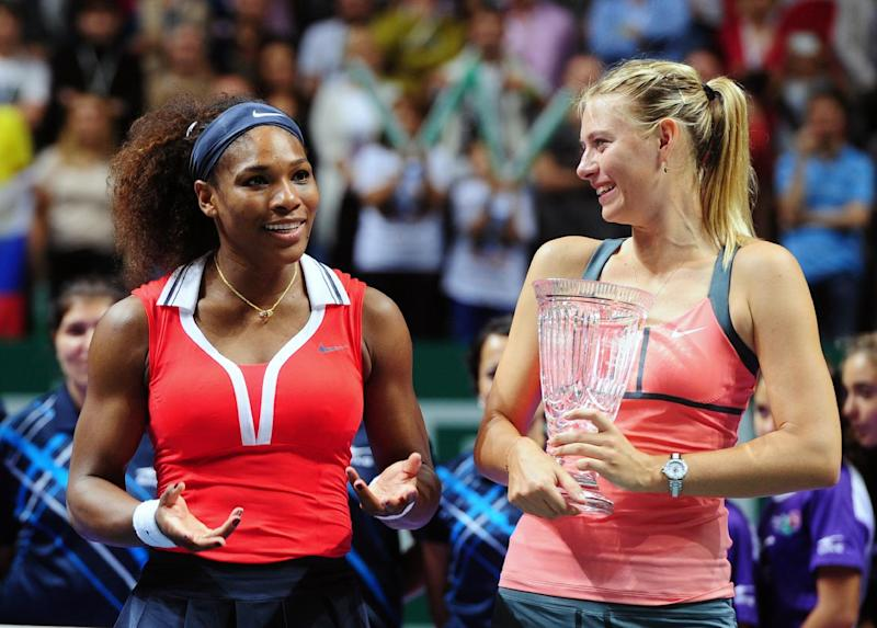 Serena Williams of the U.S., left, after her tennis victory against Maria Sharapova of Russia, right, on the final of the WTA Championships in Istanbul, Turkey, Sunday, Oct. 28, 2012. (AP Photo)