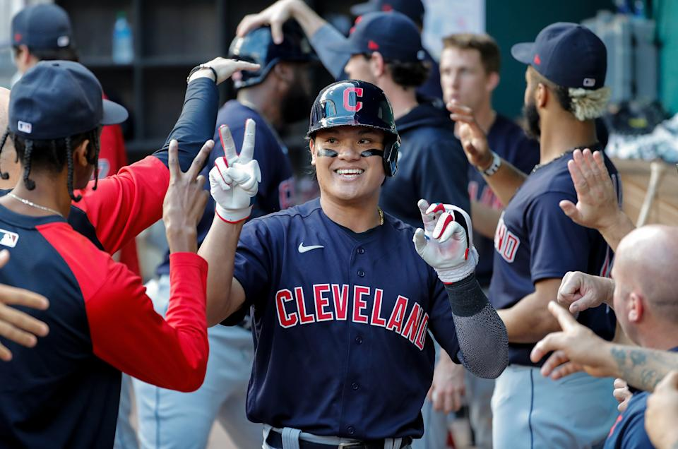ARLINGTON, TEXAS - OCTOBER 03: Yu Chang #2 of the Cleveland Indians is congratulated by teammates after a two run home run in the fifth inning against the Texas Rangers at Globe Life Field on October 03, 2021 in Arlington, Texas. (Photo by Tim Warner/Getty Images)
