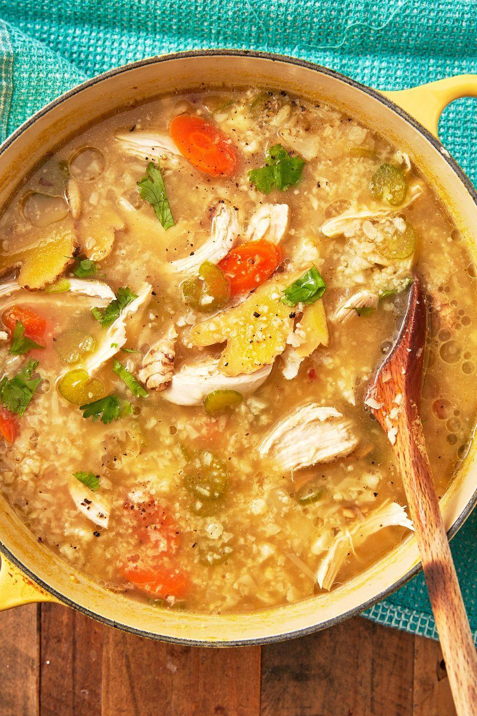 "<p>Cauliflower bulks up this soup in place of the noodles and it's still one of the most comforting soups. </p><p>Get the recipe from <a href=""https://www.delish.com/cooking/nutrition/a30326477/keto-chicken-soup-recipe/"" rel=""nofollow noopener"" target=""_blank"" data-ylk=""slk:Delish"" class=""link rapid-noclick-resp"">Delish</a>. </p>"