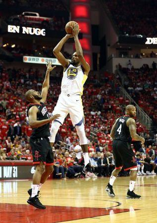 May 24, 2018; Houston, TX, USA; Golden State Warriors forward Kevin Durant (35) shoots over Houston Rockets guard R.J. Hunter (2) during the third quarter in game five of the Western conference finals of the 2018 NBA Playoffs at Toyota Center. Mandatory Credit: Troy Taormina-USA TODAY Sports